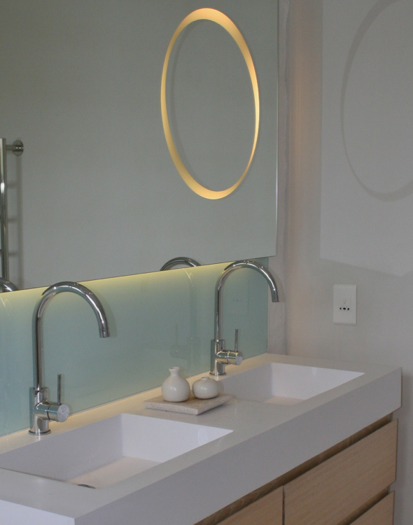 Custom made mirror designed by Bespke Bathrooms, installed at House Lundgren.