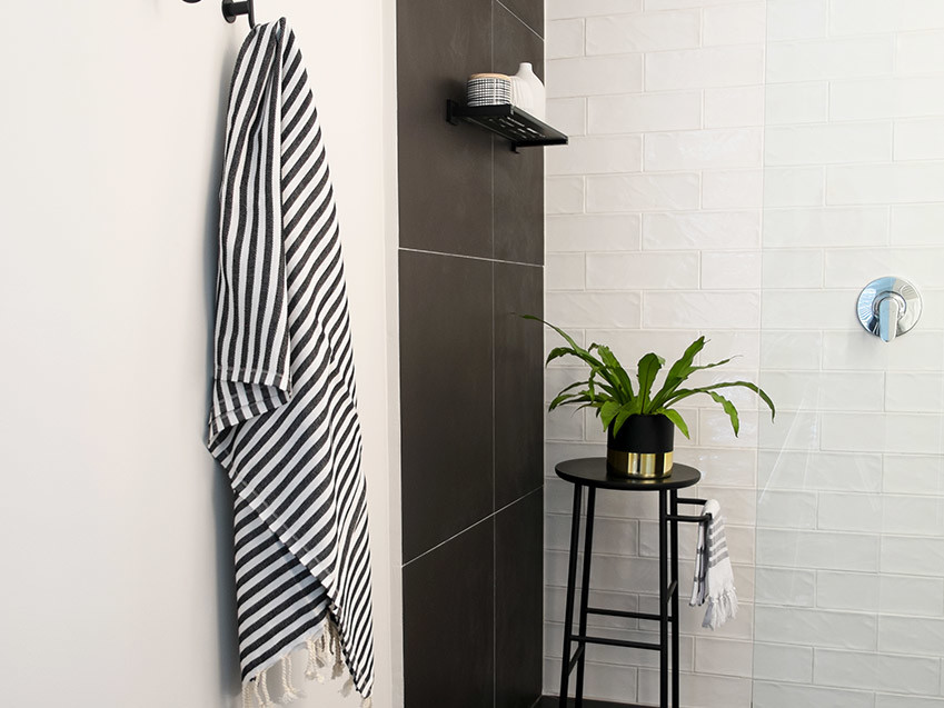 Apartment De Wet Shower with light on - Bespoke Bathrooms