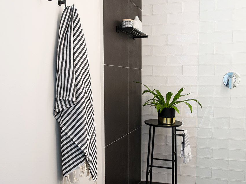 Apartment De Wet Shower with light on - Bespoke Bathrooms